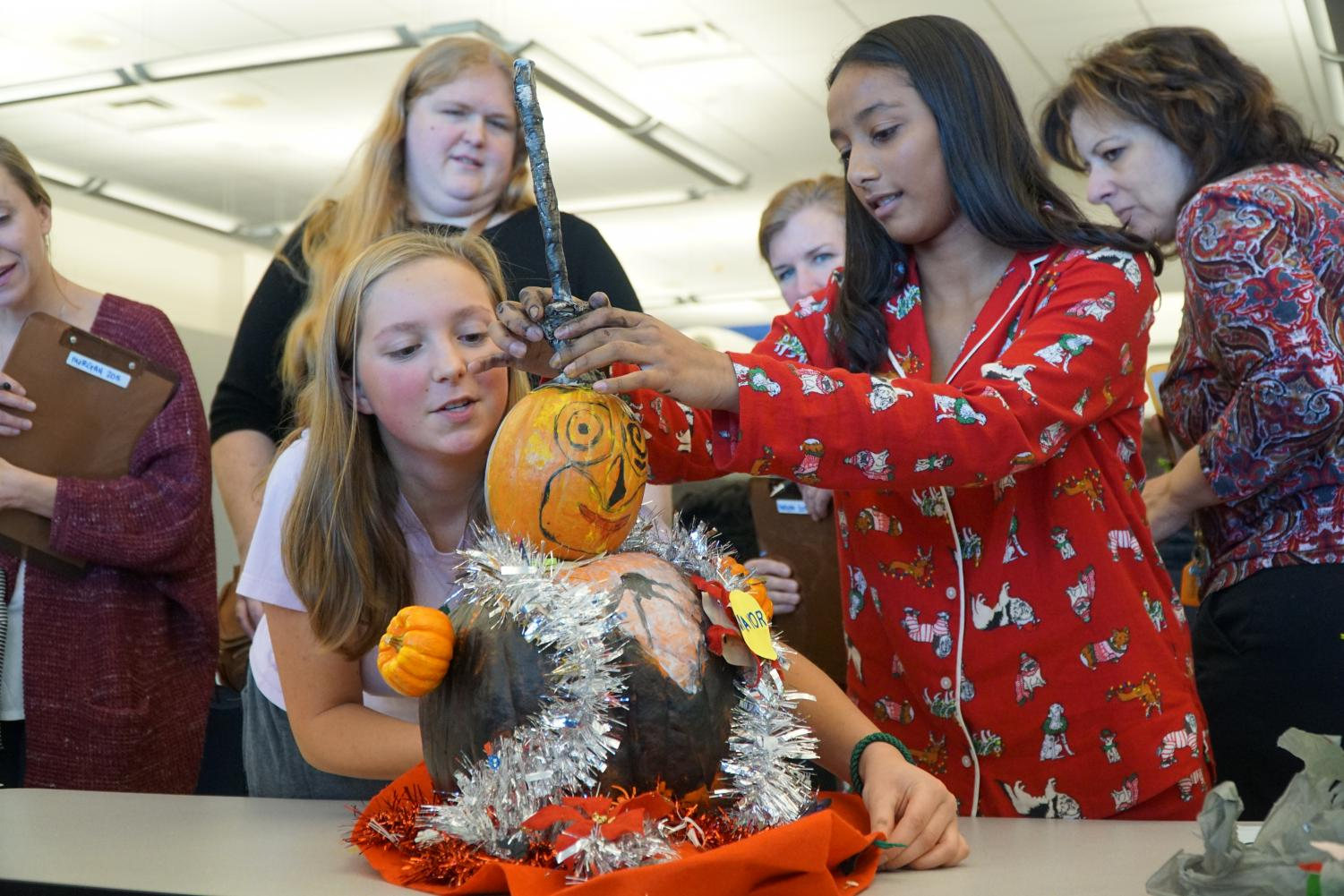 Sophomores+Georgia+Trentalange+of+Middletown%2C+left%2C+and+Mahita+Dasu+of+Marlboro+arrange+their+pumpkin+display+in+front+of+the+judges%2C+which+took+third+place.+