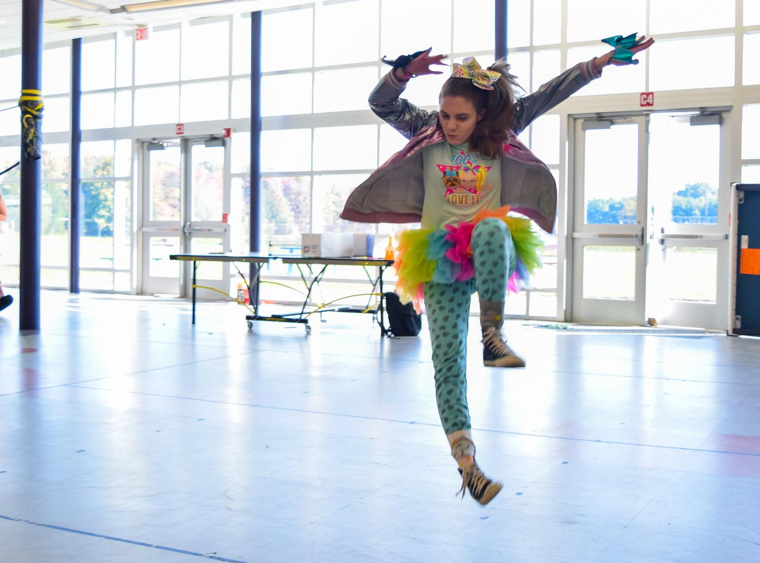 The+annual+Halloween+parade+took+place+during+lunch+on+Wednesday.+Junior+Katherine+Lombardi+of+Middletown+acts+like+dancer+and+Internet+personality+Jojo+Siwa+by+jumping+around+and+dancing.