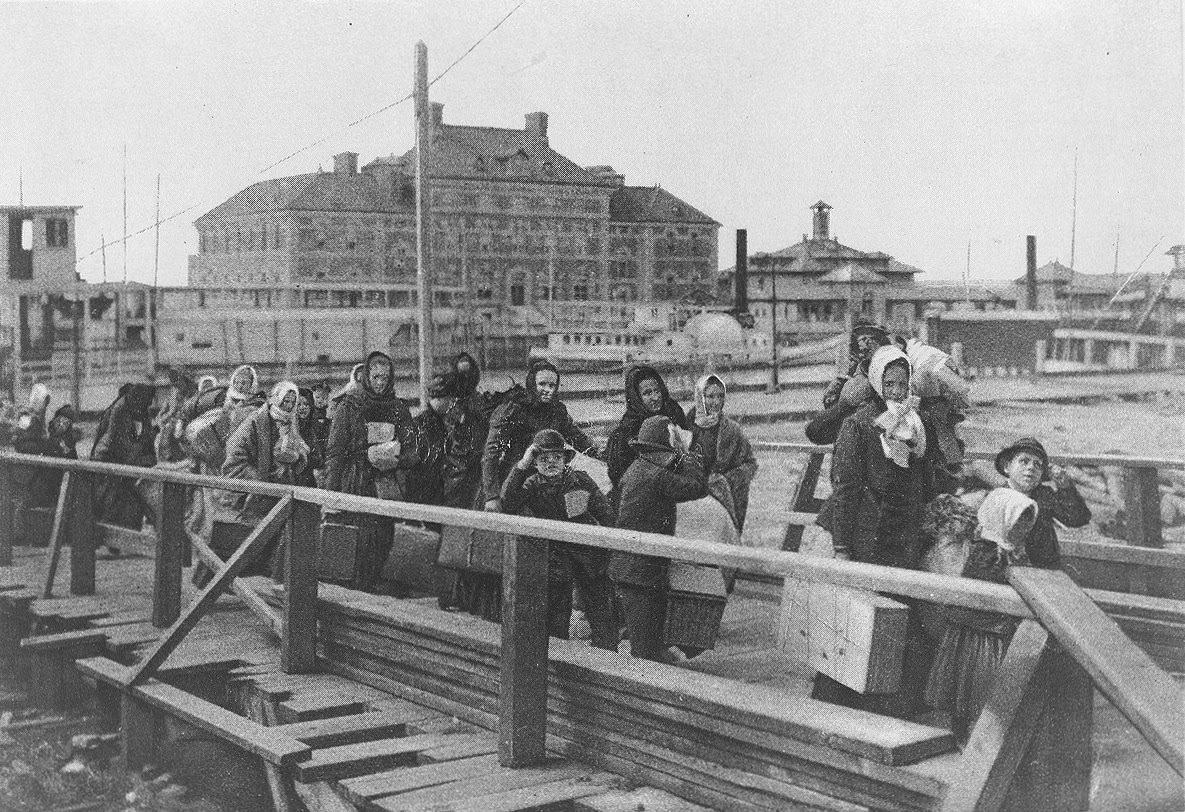 Immigrants entering the United States through Ellis Island in 1902.