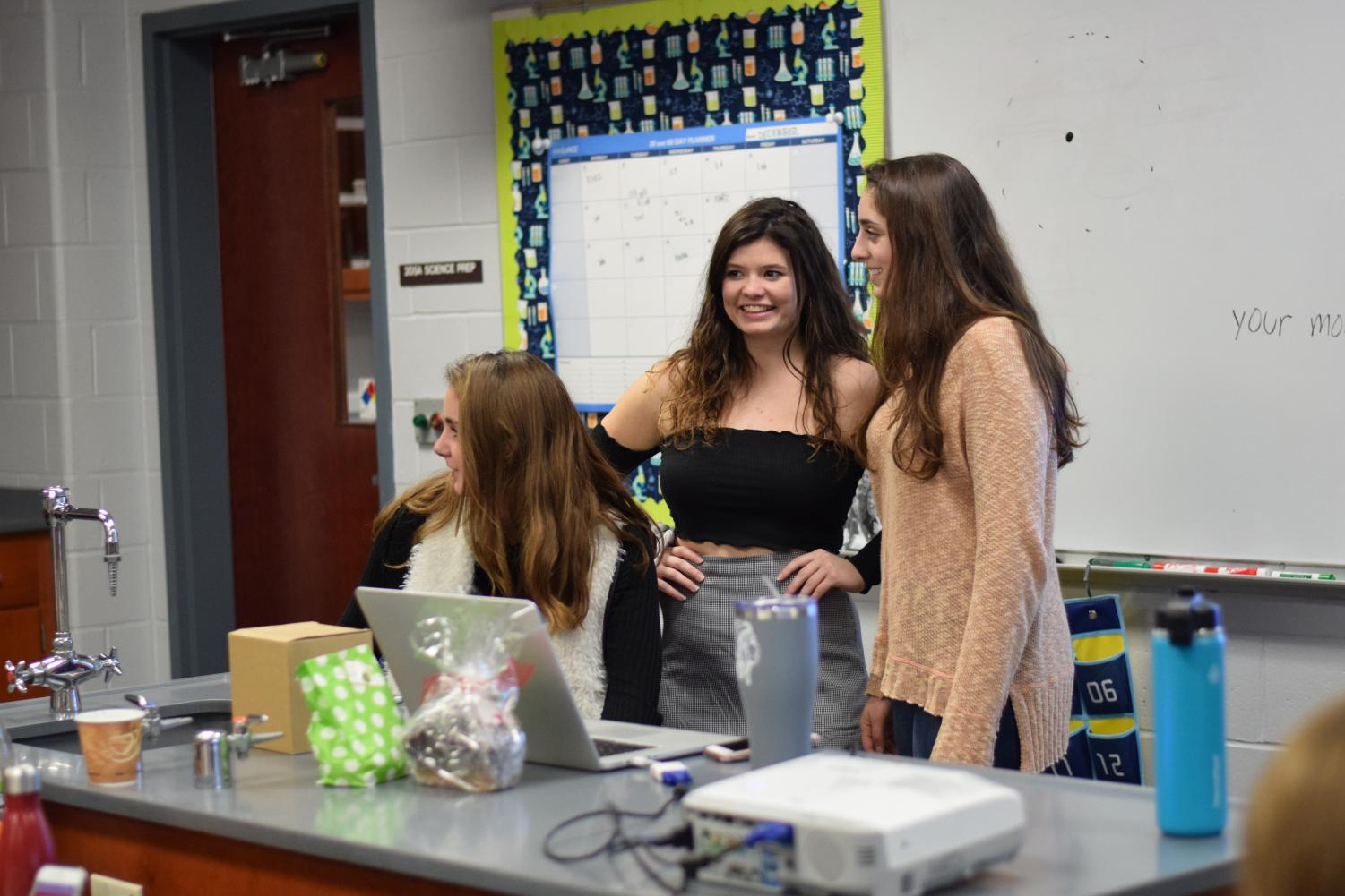 Seniors, from left, Grace Treshock of Monmouth Beach, Alex Herrmann of Brielle and Audrey Wilenta of Wall teach chemistry for Erin Wheeler. They worked with seniors (not pictured) Jules Andersen of Howell and Kathryn Jemas of West Long Branch.