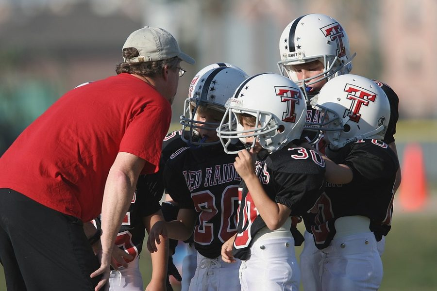 At+a+Houston+high+school+football+game%2C+a+coach+talks+to+his+team.%0Ahttps%3A%2F%2Fcreativecommons.org%2Flicenses%2Fby%2F2.0%2F