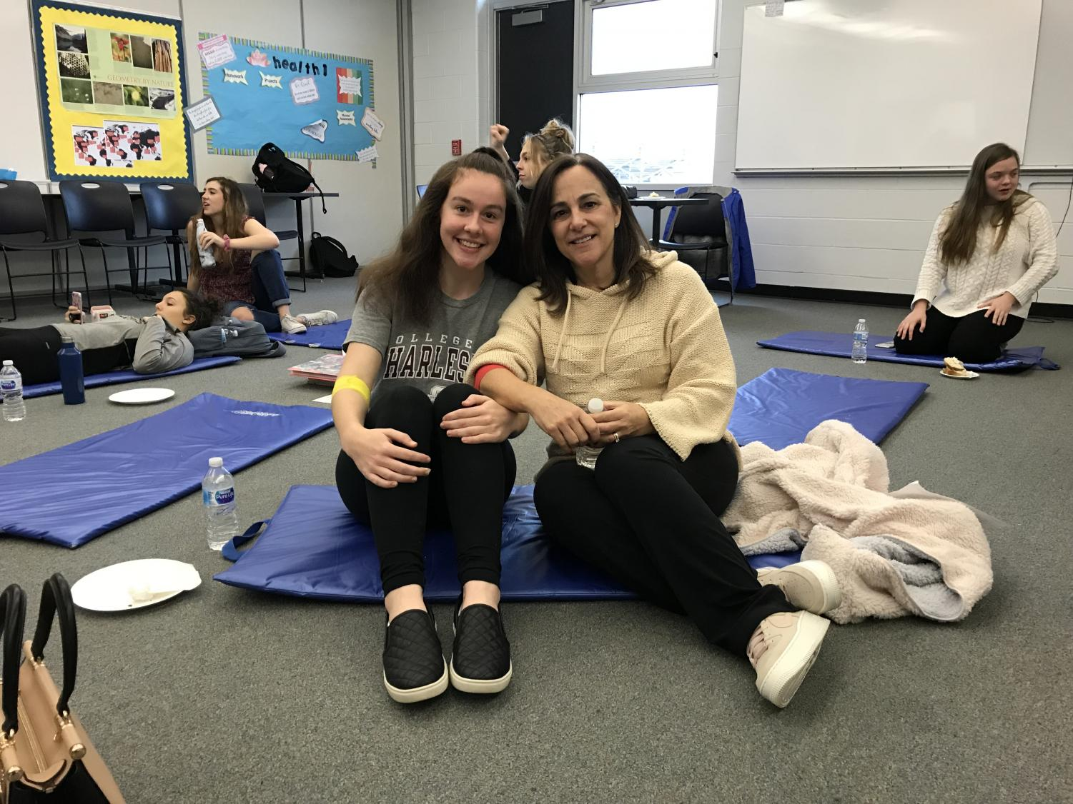 Junior Maddy Holobinko of Monmouth Beach and her mother sitting in the recovery room shortly after giving blood.
