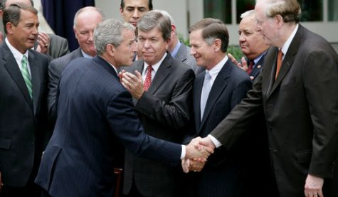Former President George W. Bush shakes hands with Senator Jay Rockefeller after signing the FISA on July 10, 2008. https://creativecommons.org/licenses/by/2.0/