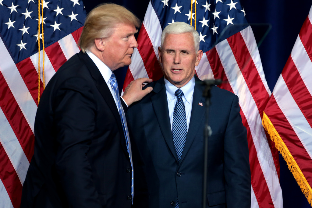 Donald Trump and Mike Pence speak before an immigration policy speech in Phoenix, AZ.