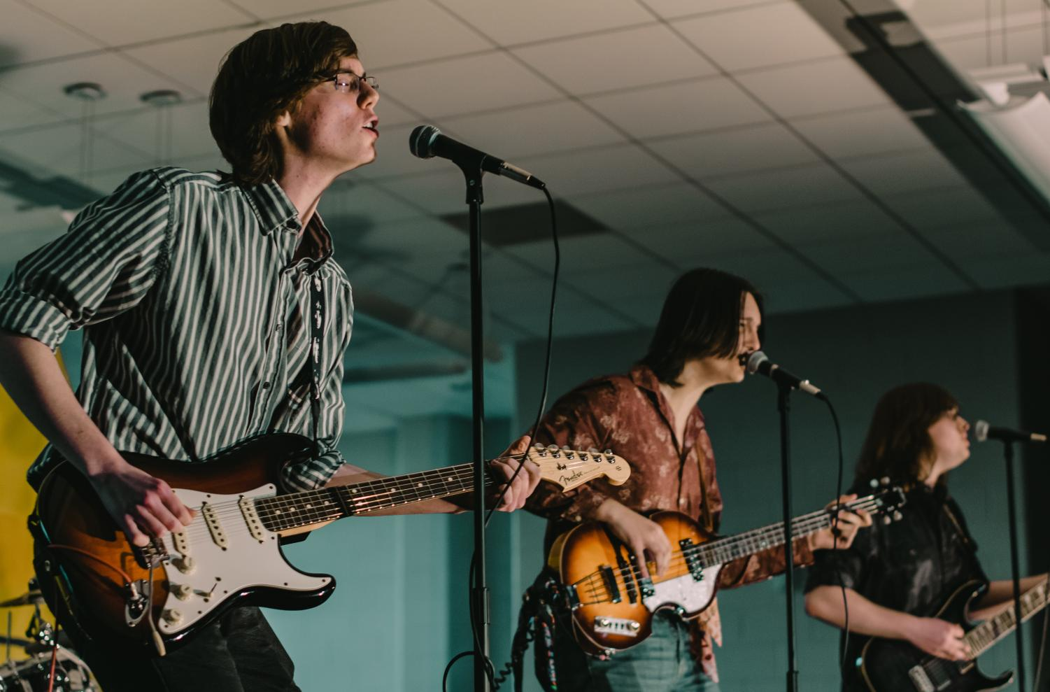 Junior Ryan Swanson of Brielle, left, and senior Kevin Clark of Spring Lake, center, won the 2019 Battle of the Bands with their band