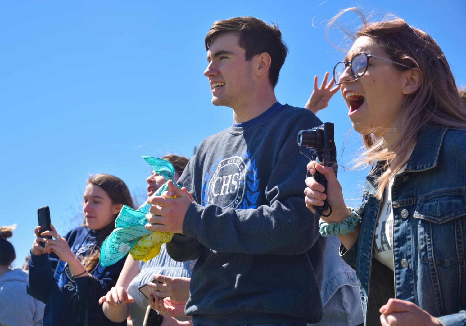 Seniors Connor Martin of Spring Lake and Kate Dickenson of Spring Lake Heights cheer on their classmates in the Spring Relay.