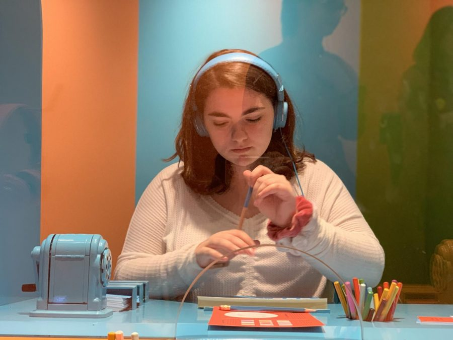 Senior Amanda Di Benedetto of Ocean draws at the Color Factory, a pop-up museum in New York City