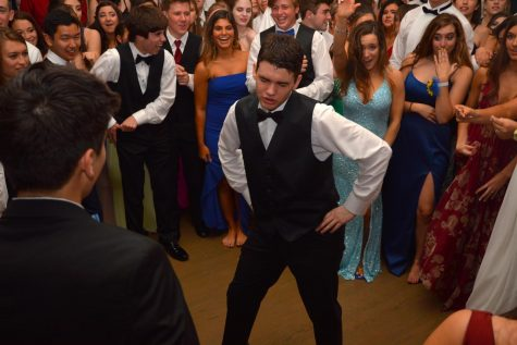 Junior Vaughn Battista of Tinton Falls dances in the center of a student-formed circle during the prom.
