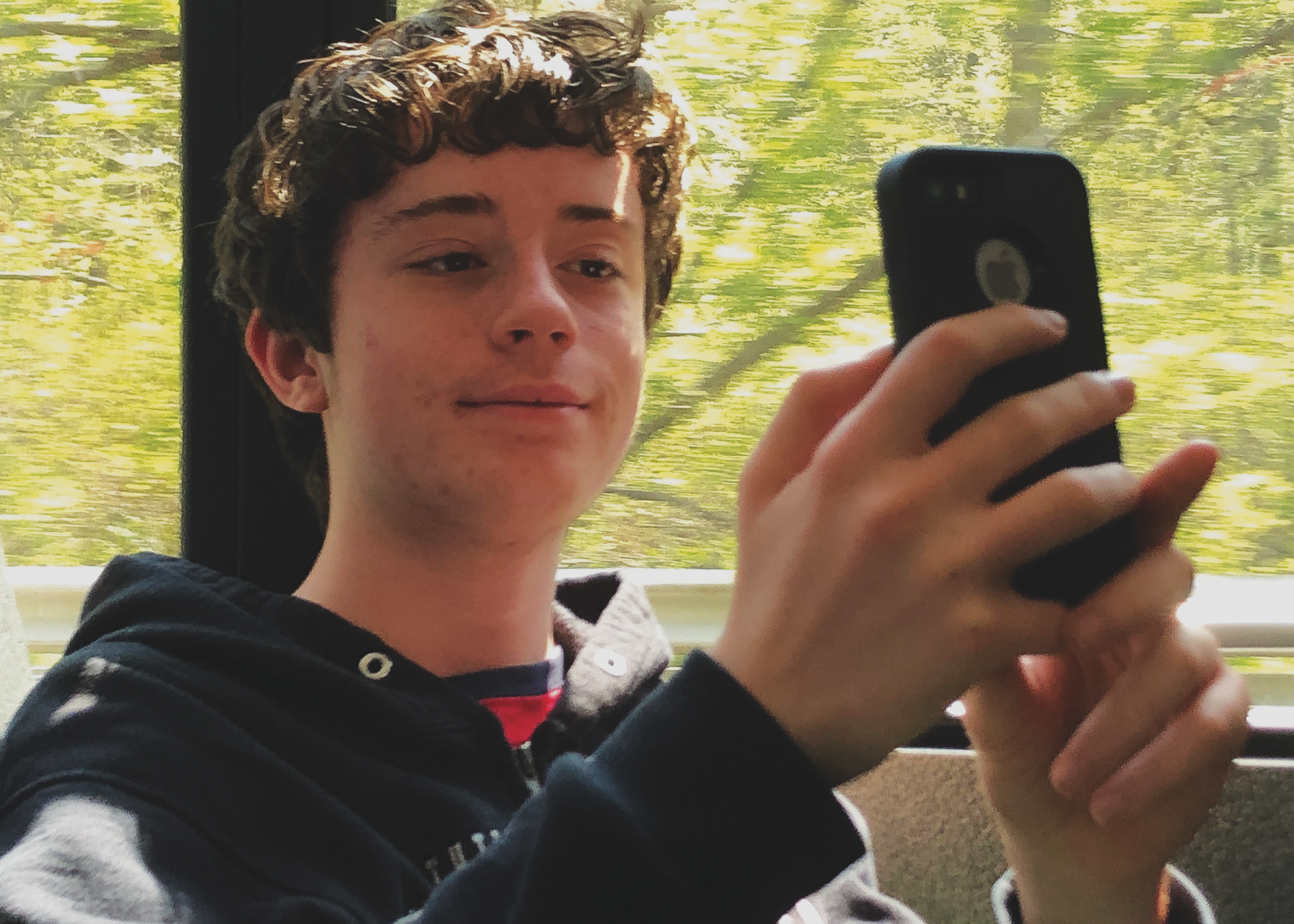 Freshman Ryan Hart of Freehold takes selfies during his bus ride home from school.