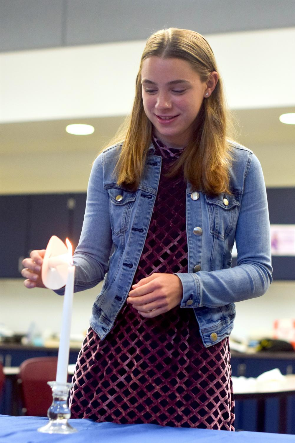 Senior Erica Sammarco of Colts Neck lights her candle using the 'candle of truth'.
