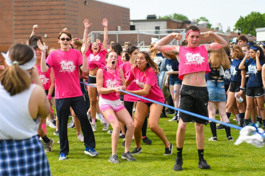 Pink+team+reacts+to+their+tug-of-war+win.