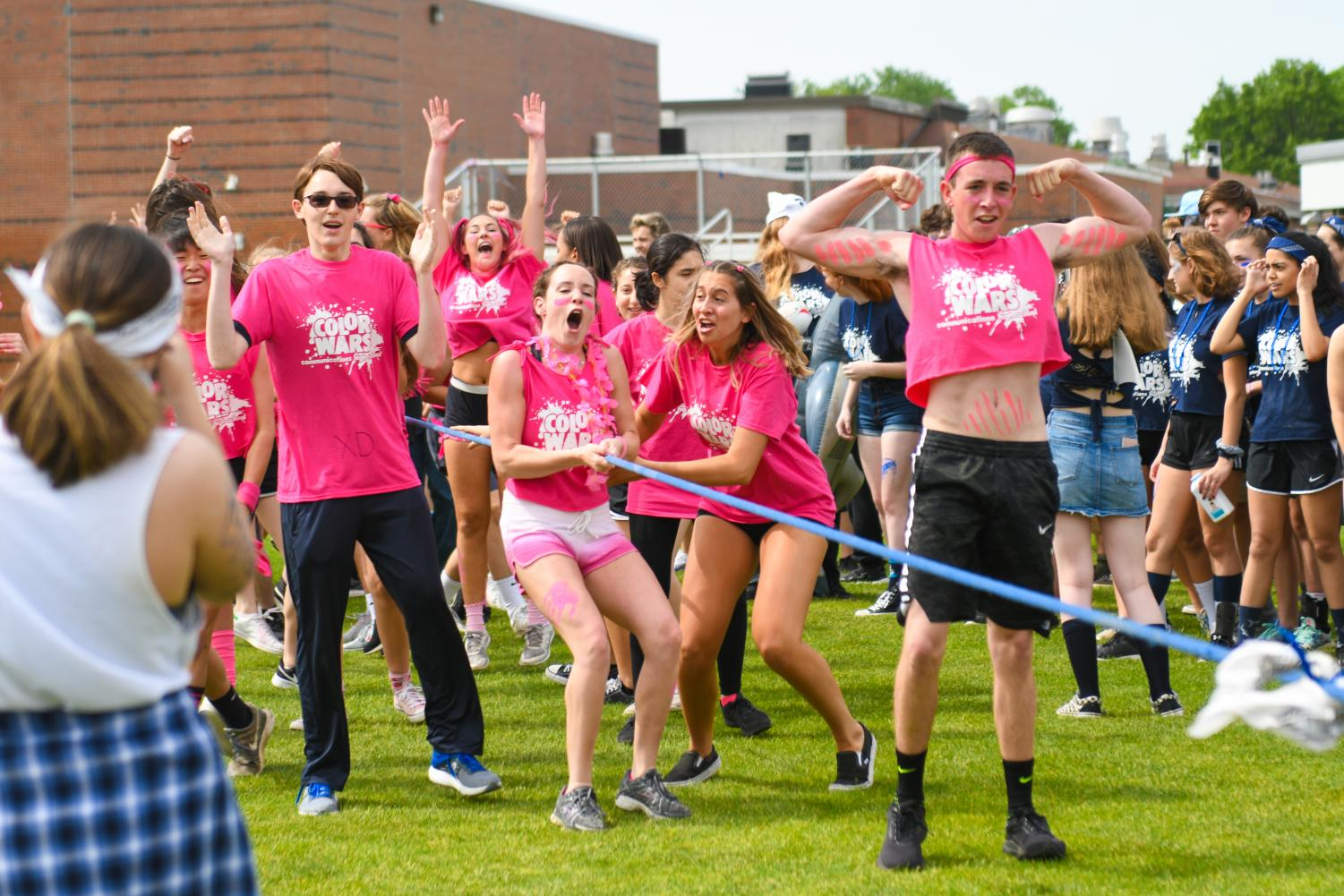 Pink team reacts to their tug-of-war win.