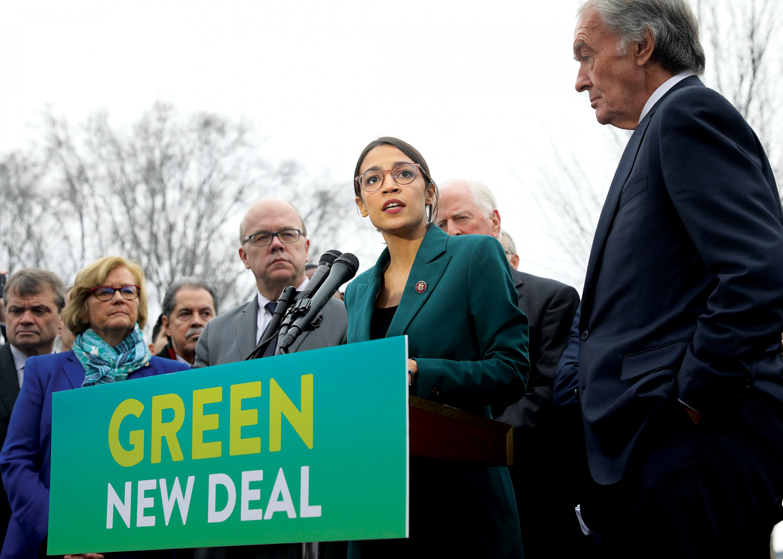Representative Alexandria Ocasio-Cortez and Senator  Ed Markey speak at the Capital Building during February 2019.