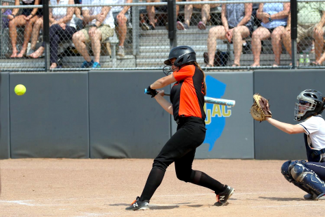 Turner prepares to hit a softball during one of her games.