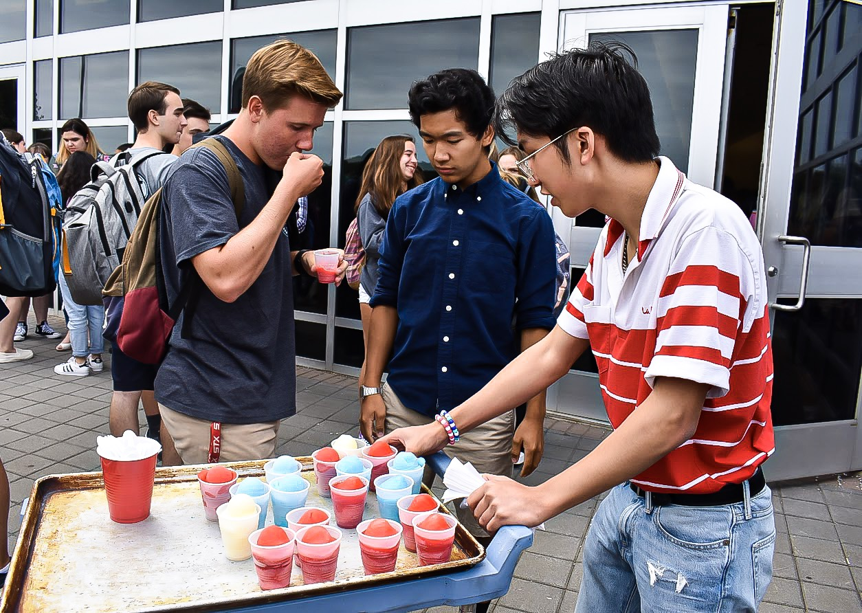 Senior Mike Cielecki of Spring Lake Heights eats italian ice with SGA members and seniors Evan Kuo of Tinton Falls and Liam Jamolod of Howell.