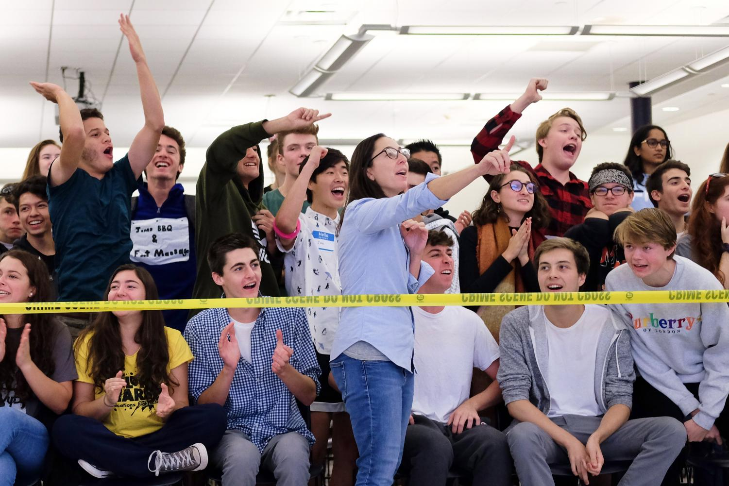 Students cheer their respective grades on during the dodgeball game on Wednesday.