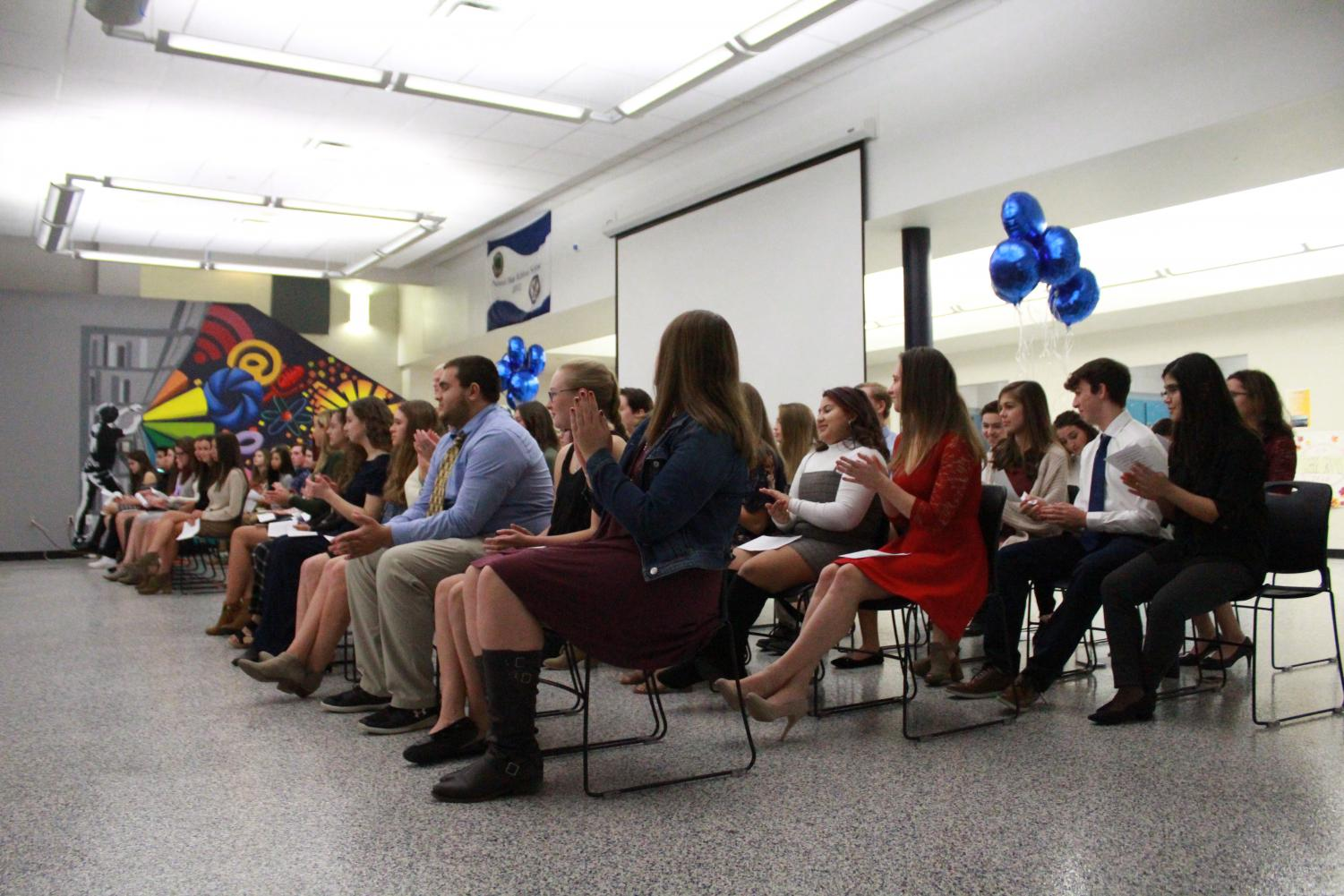 Students sit during the ceremony held on Thursday.