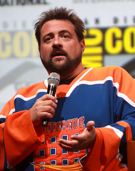 "Kevin Smith is one of the most critically controversial filmmakers working today. With well-respected films such as ""Clerks"" and ""Chasing Amy"", as well as lesser-praised films, such as ""Cop Out"" and ""Yoga Hosers,"" he has made a name for himself by simply being Kevin Smith. https://creativecommons.org/licenses/by/2.0/"