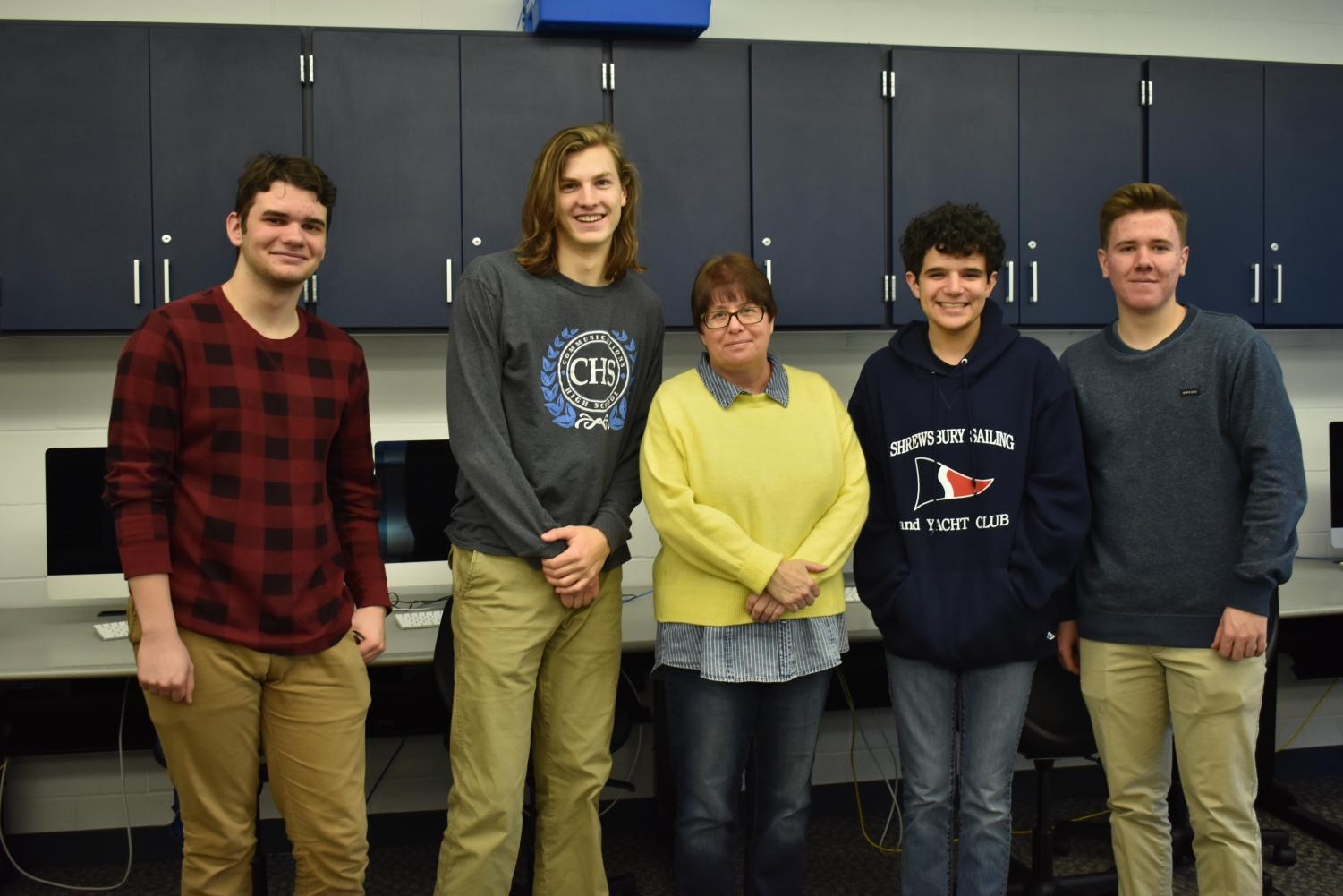 Seniors Vaughn Battista of Tinton Falls, Colin Martin of Middletown, Jack Hester of Oceanport, and Mike Cielecki of Spring Lake Heights pose with Java teacher Laura Gesin.