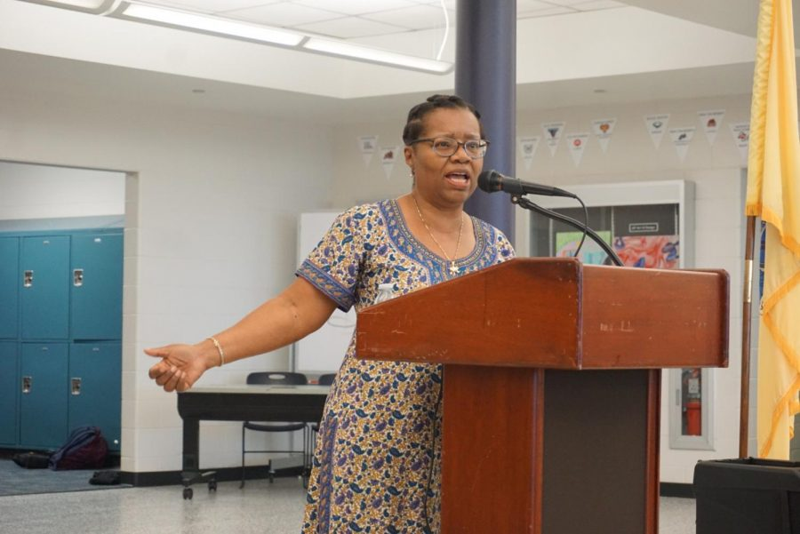 Gretna Wilkinson recites her poetry at an assembly at CHS on Thursday.