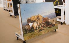Art restorers work to salvage damaged works of art