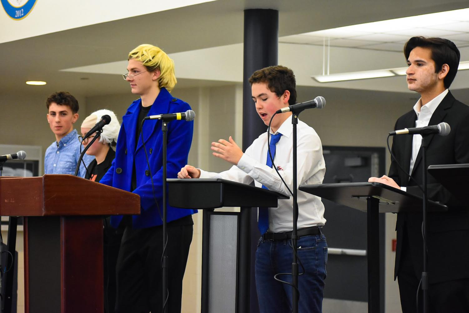 (From left to right) Freshman Joey Esposito of Tinton Falls, sophomore Maggie Schnieder of Wall, senior Colin Martin of Middletown, senior Neil Estrada of Middletown, and junior Kai Sequiera of Middletown during the mock debate on Friday.