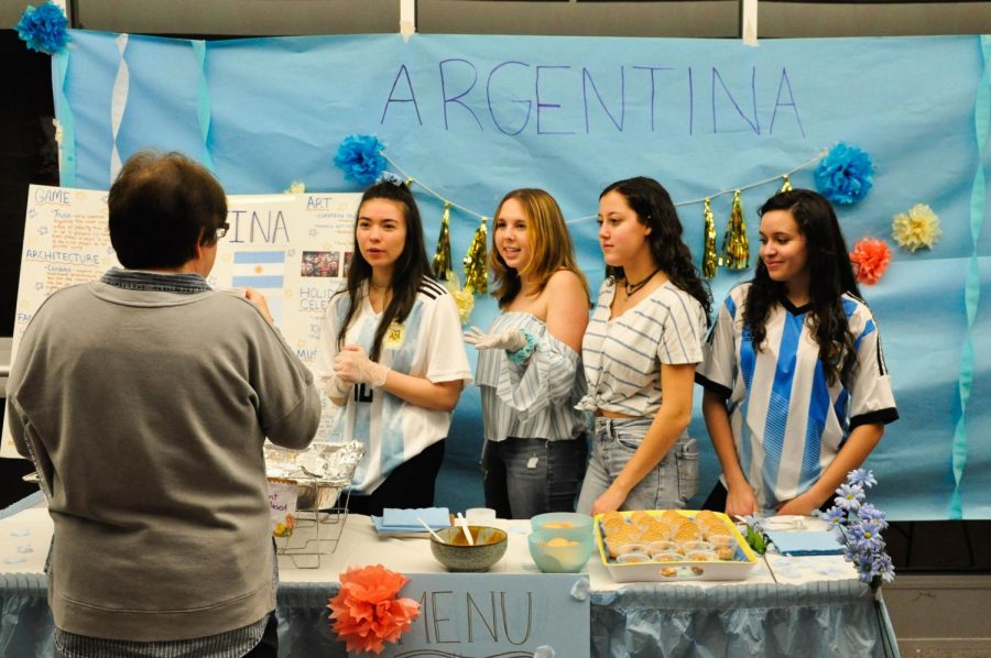 (From left to right) Teacher Laura Gesin listens to seniors Jill Fukushima of Eatontown, Alexa Feder of Millstone, Naomi Littenburg of Lincroft, and Elena Perez of Hazlet talk about their country, Argentina.