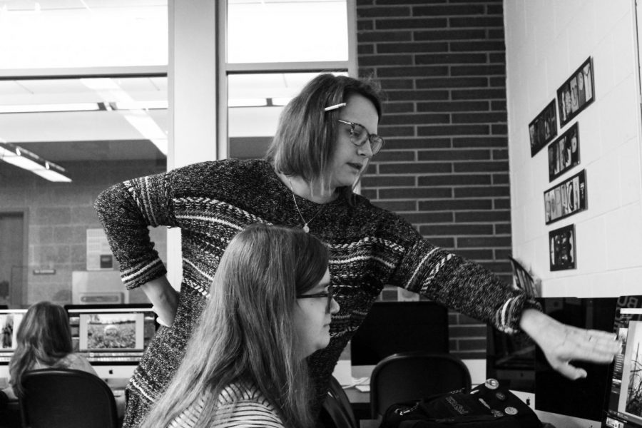 Photography teacher Amanda FitzPatrick gives feedback on a photo by junior Sara Burgi of Matawan in Photography I class.