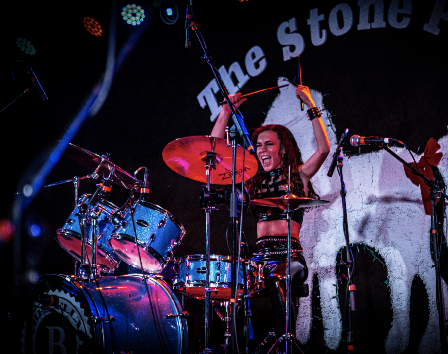 Sophomore Giulia DeFabritus of Freehold performs with her all-girl band The Bellas at The Stone Pony in Asbury Park.
