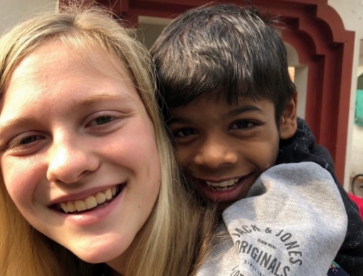 Jodry, left, holds friend Shiva on her back in January 2020 at One Life to Love Orphanage in New Delhi, India.