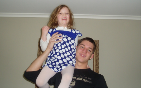 Stark, left, sits on her brother Ryan's shoulders in 2008 in her first home in Westfield, NJ. She started a foundation in his name after his overdose.