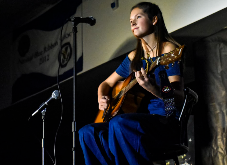 Junior Class of 2022 hosts a virtual Coffeehouse amid COVID-19 concerns. Shown above is performer Ella Lukowiak in 2019's Coffeehouse.