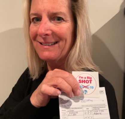 Condon displays her sticker after receiving the Moderna vaccine.