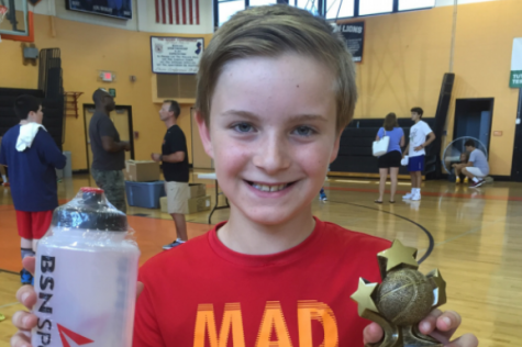 "Oldenski celebrates winning ""Most Improved Player"" at a summer basketball camp in August 2017. He was diagnosed less than a year later."