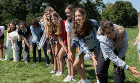 """Freshmen from the Class of 2025 participate in the Thompson Park tradition of singing the """"A-wam sam sam"""" chant. This is the first in two years freshmen have had a trip to Thompson Park."""